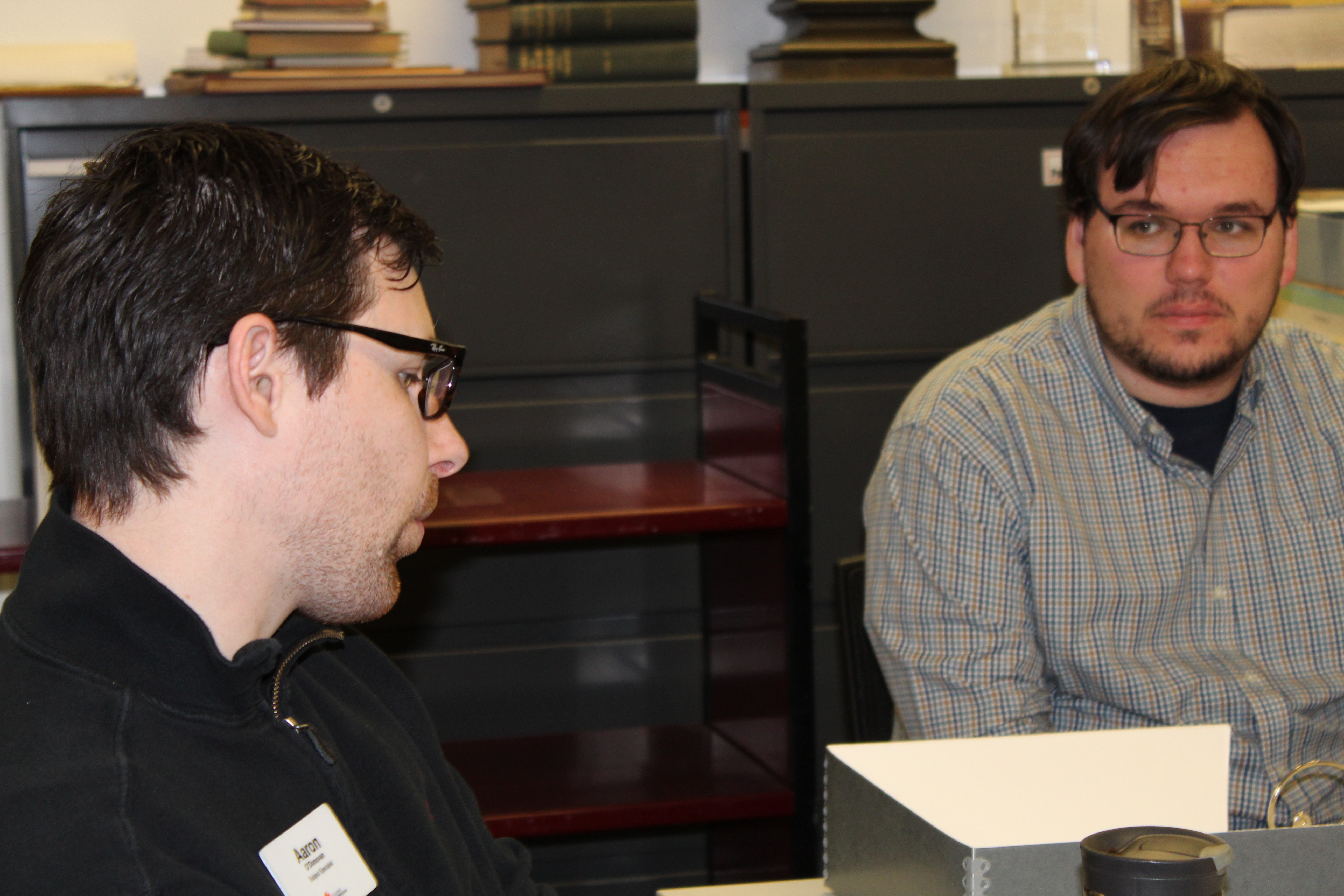 (L to R) Librarian Chuck Cody and Daniel Maharg discuss the internship project.